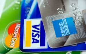 3 credit cards fanned out - Amex, Visa and MasterCard
