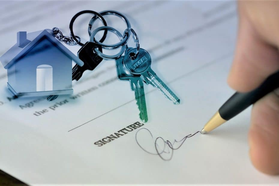 Someone signing a contract with a set of house keys on top of the paper, the keychain in a miniature house