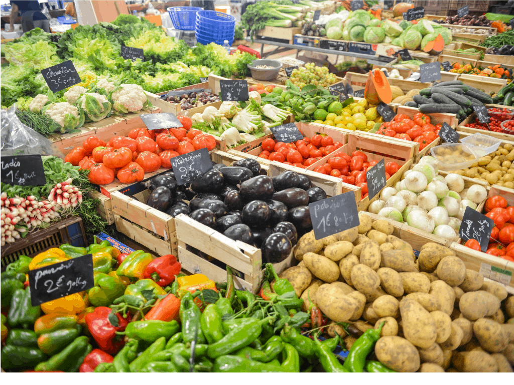 Plentiful vegetables and fruits in wooden crates at a market