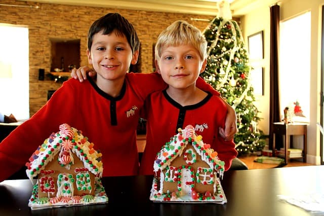friends making a gingerbread house