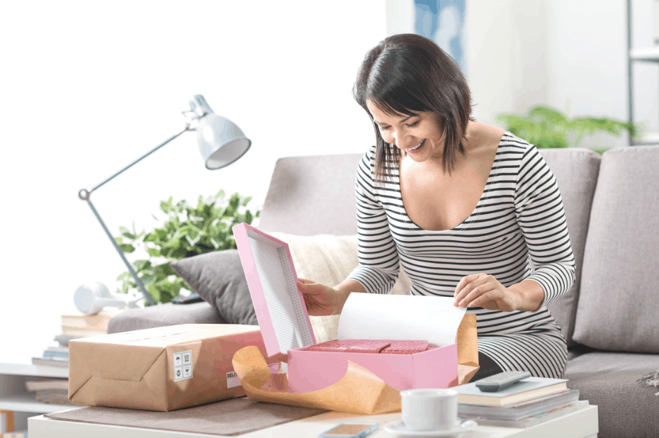 Woman opening a package from Amazon Prime Day 2019 Canada