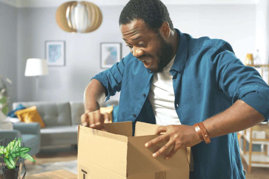 Man opening cardboard box from Amazon Prime Day