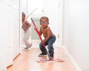 Young boy cleaning the floor