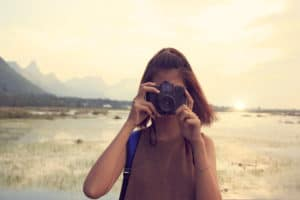 Young woman taking photo on vacation