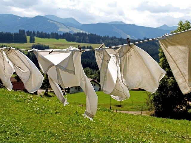 hanging laundry with fields and mountains